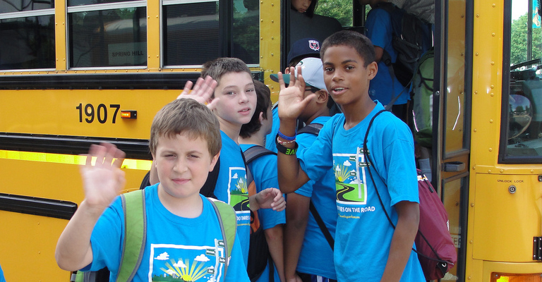 Campers getting on Camp Goodtimes Bus