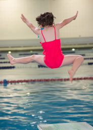 girl jumping off diving board