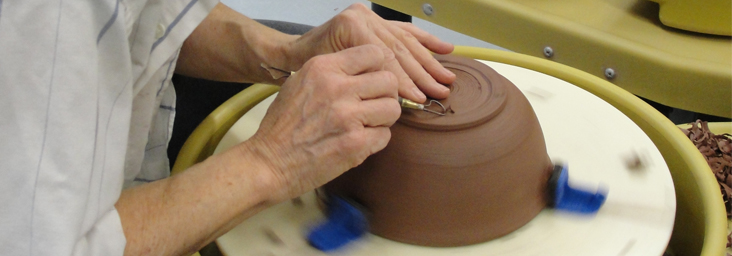 artist using potters wheel